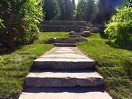 Entré et aménagement de mure de pierre  en palier a tremblant